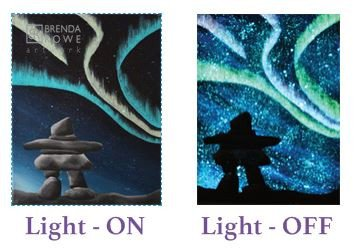 standing in the light inukshuk northern lights